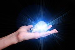 Blue lightbulb Stock Images