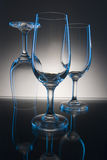 Blue lighted glasses on table Royalty Free Stock Image