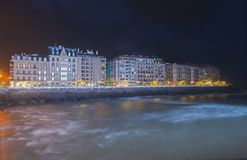 Blue lighting on the Urumea river, Cantabrian sea and the buildings of the city of Donostia Stock Images
