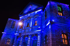 Blue lights on church facade Stock Images