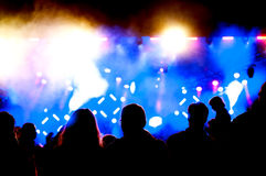 Blue lights concert. Crowd next to the colourful and blue concert lights Royalty Free Stock Photos