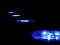 Blue lights in the dark Stock Images