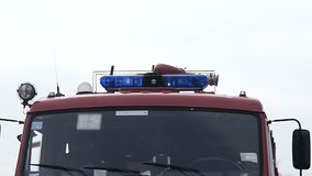 Blue lights on the fire truck siren. Close-up picture of blue lights and sirens on a fire-truck stock footage