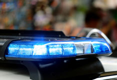Blue lights of a police car in the big city. Flashing blue lights of a police car in the big city Royalty Free Stock Photos
