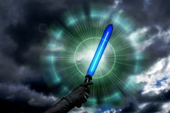 Blue lightsaber. Laser sword against the sky Stock Image
