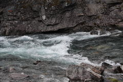 Blue limpid crear water in the river of Norway. Stock Images