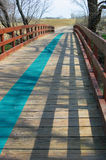 The Blue Line. A bridge over a creek in Allen, Texas, features a blue line. The trail is at the Twin Creeks Golf Course Royalty Free Stock Image