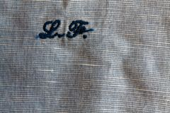 Blue linen close-up texture or background with initials Royalty Free Stock Images