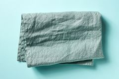 Cotton napkin on blue, from above. Blue linen napkin on blue background, top view royalty free stock image