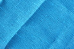 Blue linen texture. Blue linen cloth texture with diagonal fold Royalty Free Stock Image