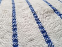 Blue lines. On a cloth, white cloth with bold stripes royalty free stock image