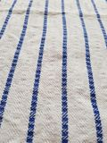 Blue lines. On a cloth, white cloth with bold stripes stock photography