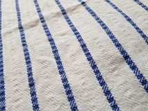 Blue lines. On a cloth, white cloth with bold stripes royalty free stock images