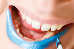 Blue lips. A woman with blue lipstick stock image