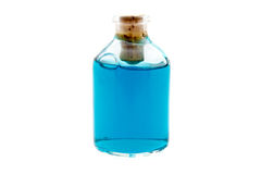 Blue liquid in the bottle Royalty Free Stock Image