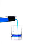 Blue liquid poured into a glass Royalty Free Stock Images