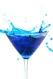 Blue liquid pouring into glass. Blue liquid pouring into martini glass Royalty Free Stock Photo