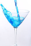 Blue liquid pouring into glass Stock Image