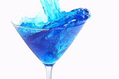 Blue liquid pouring into glass Royalty Free Stock Photo