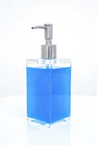 Blue liquid soap in transparent bottle Royalty Free Stock Photography