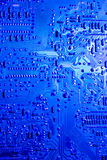 Blue lit computer circuit board Stock Images