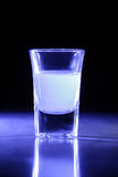 Blue Lit Shot Glass. Shot glass lit by a blue light from the side Royalty Free Stock Photos