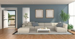 Blue living room with open entrance door royalty free stock photo