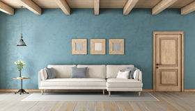 Blue living room with white sofa Royalty Free Stock Images