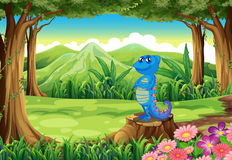 A blue lizard above the stump at the forest Royalty Free Stock Photos