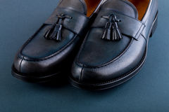 Blue loafer shoes on blue background. One pair. Close up. Stock Image