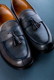 Blue loafer shoes on blue background. One pair. Top view. Royalty Free Stock Photo