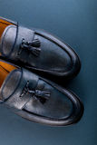 Blue loafer shoes on blue background. One pair. Top view. Royalty Free Stock Image