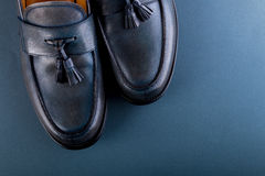 Blue loafer shoes on blue background. One pair. Top view. Stock Image