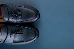 Blue loafer shoes on blue background. One pair. Top view. Copy space. Royalty Free Stock Images