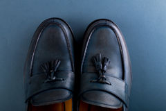 Blue loafer shoes on blue background. One pair. Top view. Copy space. Royalty Free Stock Photo