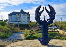The Blue lobster by the Captain Cook Inn, in Staithes, near Scarborough, in North Yorkshire. stock images
