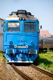 Blue locomotive. Front view of a blue locomotive, entering in to the station Royalty Free Stock Photography
