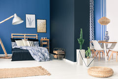 Blue loft space. Multifunctional blue loft space for young person stock image