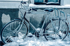 Blue look at ice icicles on a parked bicycle Stock Images