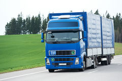Blue lorry with trailer over blue sky Royalty Free Stock Photos