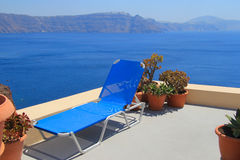 Blue lounge chair against the sea, Santorini. Greece Royalty Free Stock Images