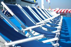 Blue lounge chairs on deck Royalty Free Stock Photography