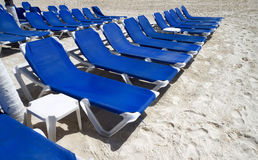 Blue Lounge Chairs. Rows of blue several lounge chairs on the beach Stock Photography
