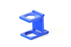 Blue Loupe. A photographic loupe on a white surface Royalty Free Stock Images