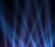 Blue luminous rays on a dark background Stock Image