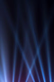 Blue luminous rays on a dark background Royalty Free Stock Photography