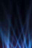 Blue luminous rays on a dark background Stock Images