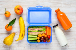 Blue Lunch Box with Fruits and Milk Royalty Free Stock Images