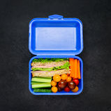 Blue Lunch Box with Sandwich and Vegetables Stock Photo