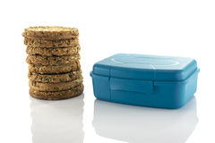 Blue lunchbox and stack of rusks Royalty Free Stock Image